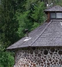 Round cordwood house